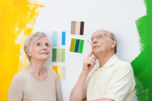 Older couple looking around painted room