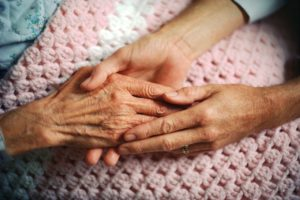 Holding elderly person's hand