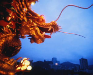 Golden dragon with city in background