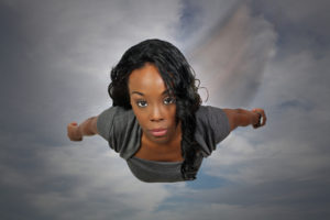 Super Woman flying through the sky