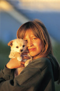 Lonely woman holding a puppy