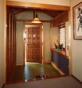 Home entryway with door slightly open